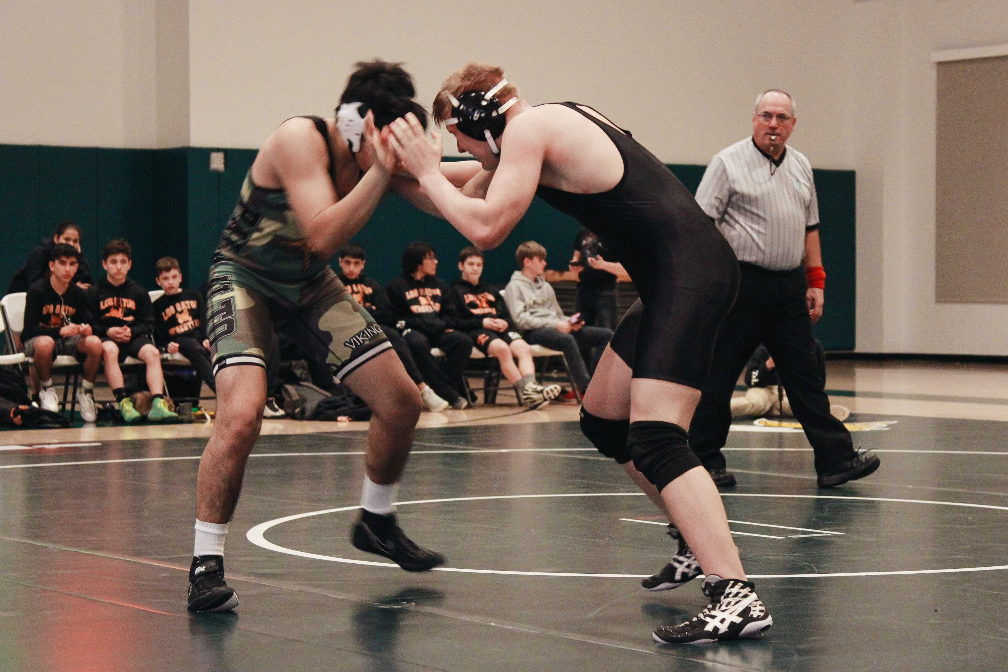 "Palo Alto High School sophomore Nathan Sanchez grapples with his opponent on the mat. Though Paly lost to Los Gatos 48 - 28, the team is hoping to do well at league tournaments coming up. ""Everybody wants to do well, but top 4 at leagues is what will send you to CCS so that's a lot of people's goals,"" senior Elliot Clark said. Photo: Angelina Wang."