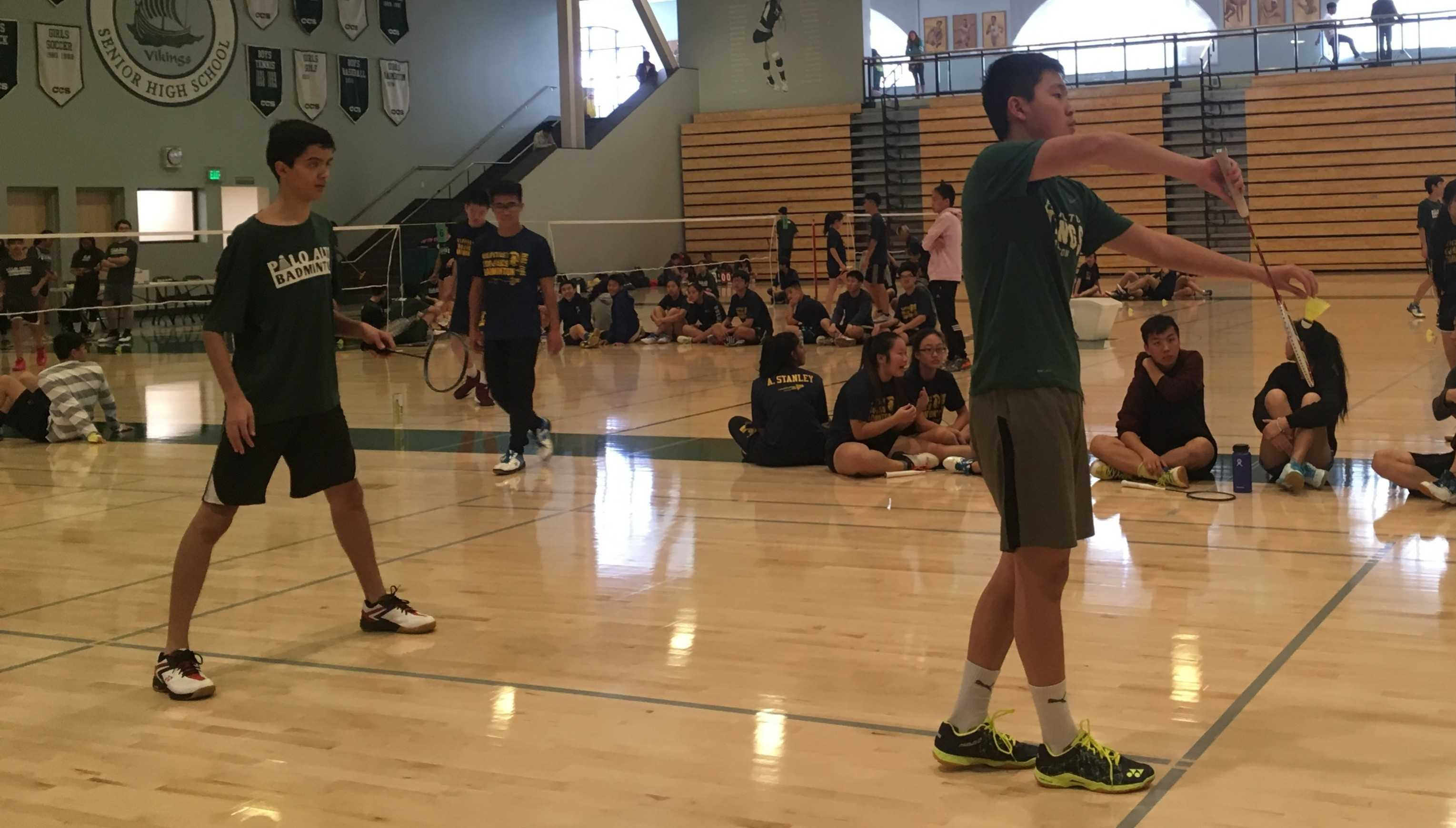 "Palo Alto High School sophomore Jeffrey Mi prepares to serve the birdie to players from Milpitas High School in yesterday's boys' varsity one doubles badminton match. Mi and senior captain Tilak Misner went on to lose, 2-1. ""I hope to play better in my next game,"" Mi said. Photo: Soumya Jhaveri"