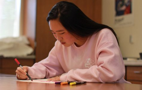 Palo Alto High School senior Iris Yuan works on one of her lettering pieces. She shares her work on Instagram, under the handle @irissletters, and recently gained 1,000 followers.