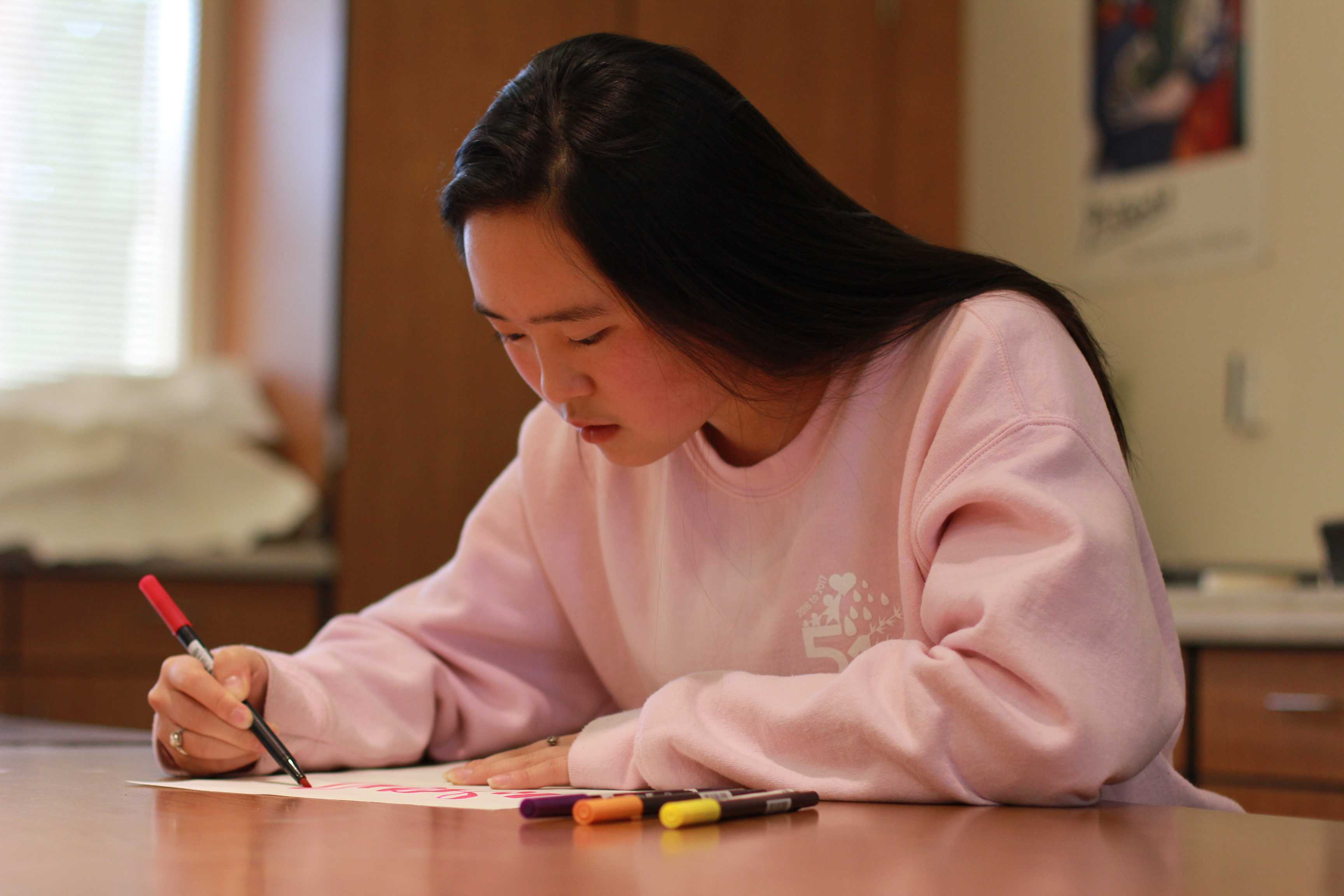 "Palo Alto High School senior Iris Yuan works on one of her lettering pieces. She shares her work on Instagram, under the handle @irissletters, and recently gained 1,000 followers. ""I started my Instagram so I can hold myself accountable for my lettering and keep it up, because I'm also someone who drops a lot of hobbies,"" she said."