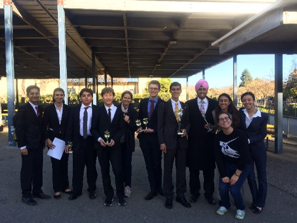"The Palo Alto High School speech and debate team poses for a photo. 4 members of the team went undefeated, guaranteeing them a spot at the state qualifying tournament. ""I think a big part of our team is the camaraderie we have formed when we work together,"" sophomore Kai Vetteth said."
