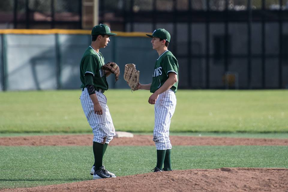 Freshman third baseman Aidan Berger meets on the mound with senior pitcher James Roake during a game against Los Altos. Roake closed the game, receiving the pitching win. Photo: Karen Hickey