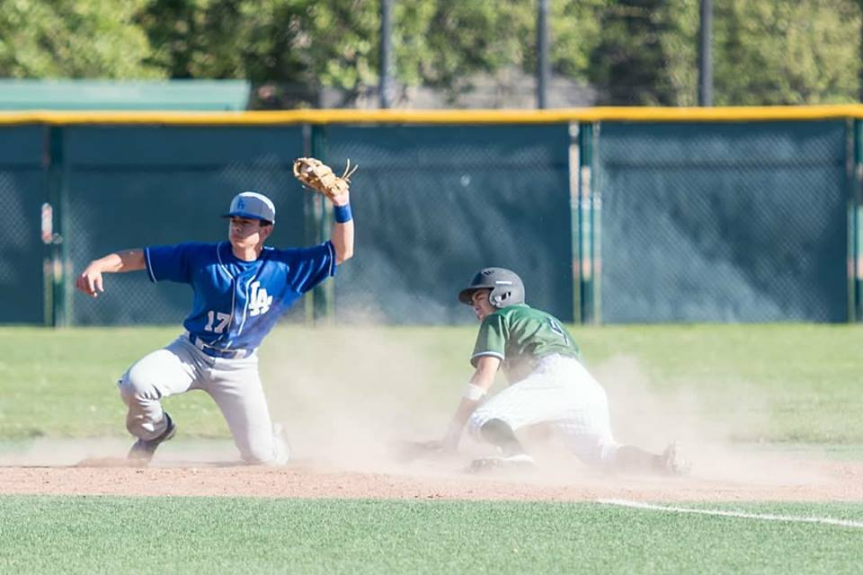 Freshman third baseman Aidan Berger slides into second base in a home game against the Los Altos Eagles (RECORD). Berger hit .333 with one RBI, aiding a Viking 4-2 victory over the Eagles. Photo: Karen Hickey