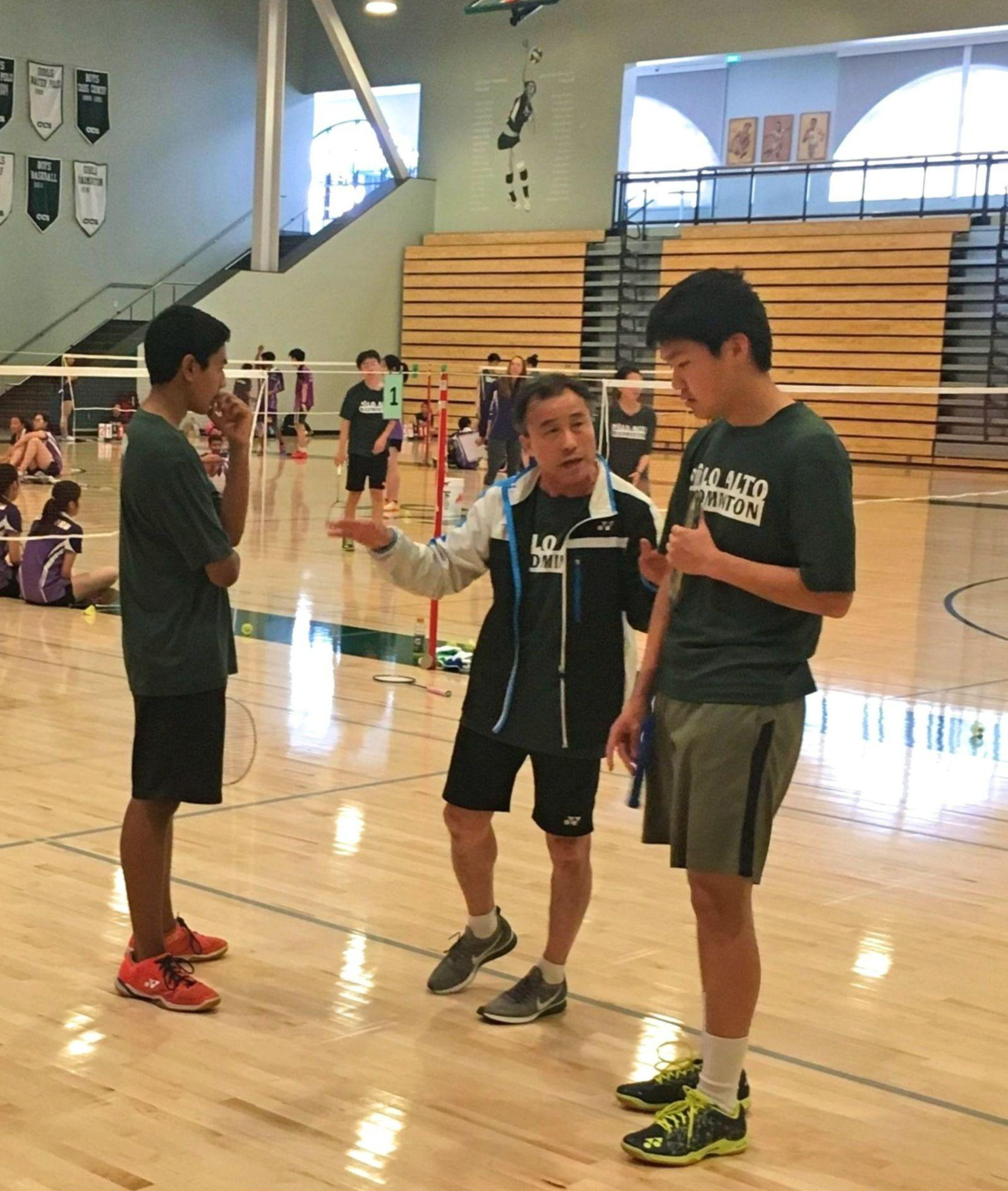 "Junior Zakir Ahmad and sophomore Jeffrey Mi strategize with Coach Kenny Chung in between the first and the second badminton game. Mi said the coach told them to try and move the other team around more. ""His advice helped us a lot,"" Mi said. ""We played a lot better in the second game."" Photo: Marvin Zou"