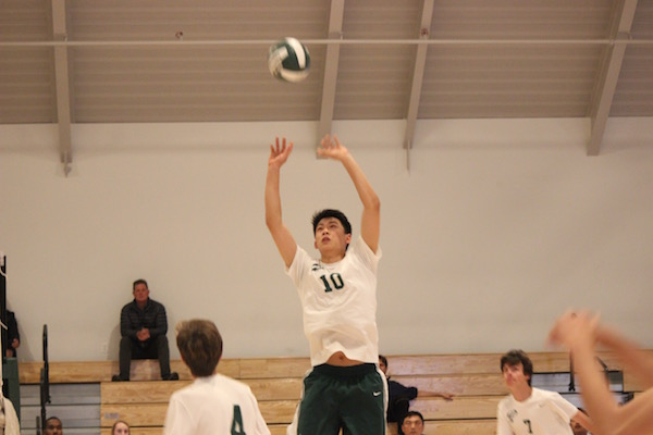 Junior setter Raymon Chen soars to set senior middle Bryce Doughman in the Vikings' matchup against Eastside College Preparatory on April 28 in The Peery Family Center. Chen led Paly with multiple beautiful sets coupled with powerful swings from setter. The Vikings won the match in three sets.