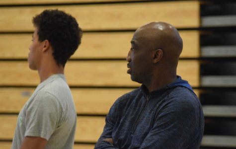 "New boys basketball head coach Rodney Tention (left) observes a scrimmage to gauge the skills of his players next year. Tention has years of coaching experience, and looks to improve the team during his time here at Paly. ""I want to challenge them, but make sure they understand they are good enough to be a top level team,"" Tention said. Photo: Dylan Zou"