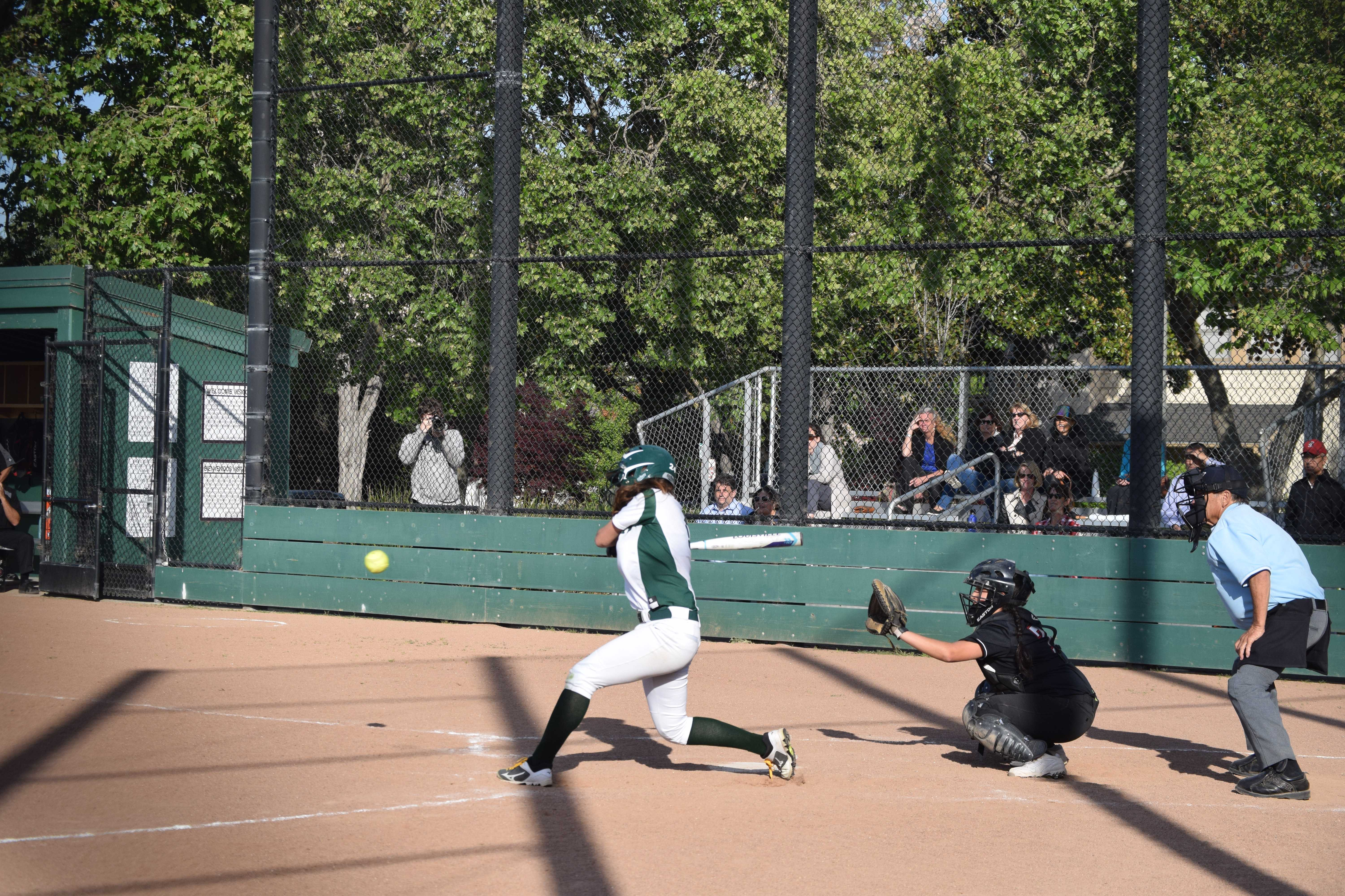 Sophomore Zoe Silver swings at the ball in the first inning in a matchup against Gunn High School.