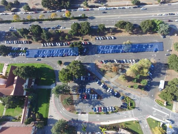 "This aerial photo shows the proposed locations of the solar panels that REC Solar will build in Palo Alto High School's El Camino parking lot. Members of the community have criticized the solar panels for ruining the campus's aesthetic and uprooting trees in the parking lot. ""Placing tall metal carports within the front boundaries of the Haymarket and Tower complex drastically changes the open inviting view of these iconic buildings that people have enjoyed for over 100 years,"" Paly librarian Rachel Kellerman said."
