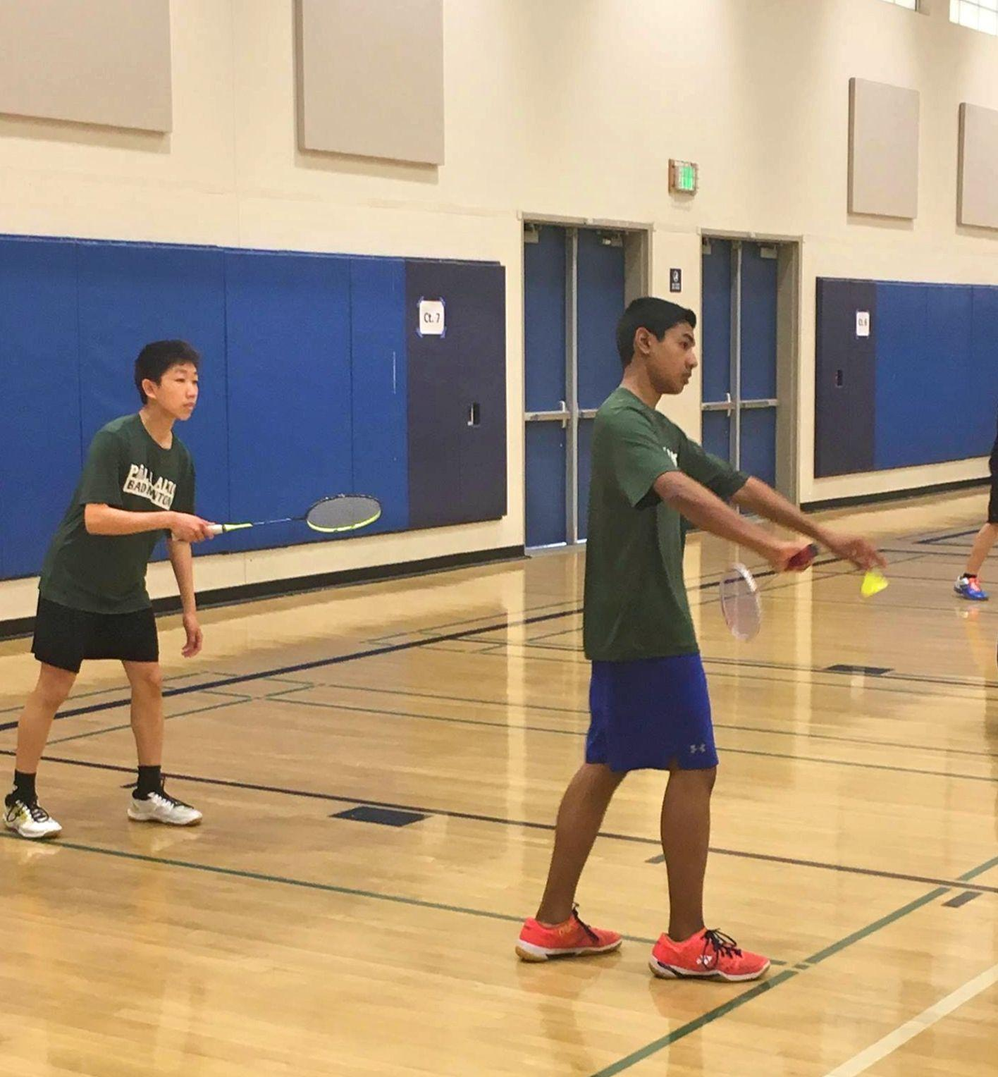"Boys badminton doubles player Zakir Ahmad (right) prepares to sneak in a quick serve against Lynbrook. Despite losing the intensely-close game to a matter of mere points, the Vikings say that they have improved in many areas, from racket skills to footwork. ""This year we have a new coach, so we have a new training system, which I think is better because we do footwork a lot more,"" Mi said."