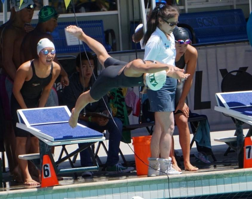 """A Palo Alto High School swim team member cheers on her fellow teammates at the Central Coast Section swimming competition at Santa Clara. The CCS swimming competition is one of the most prestigious meets Paly participates in. """"We have always been proud of CCS qualifiers throughout the season,"""" said coach Danny Dye. Photo: Chesnie Cheung."""