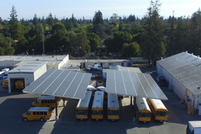 New solar panels gleam in Palo Alto High School's parking lot. The panels will begin generating power later this year and will save PAUSD a total of $600,000 over the course of their 25-year commercial life.