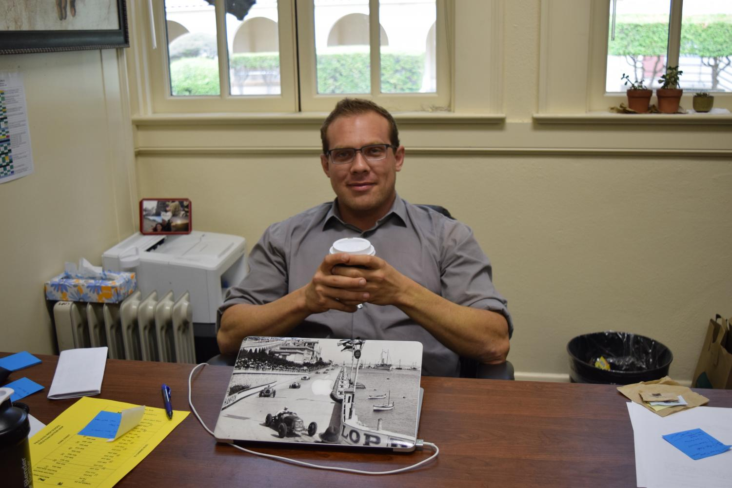Assistant Principal John Christiansen enjoys a cup of coffee while discussing his transition to Palo Alto High School, his responsibilities at Paly and his passions outside of his career. Although part of the school's administration team is new this year, Christiansen said that consistency to years prior can be expected.