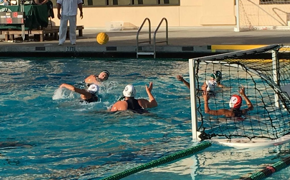 A Palo Alto High School varsity girls' water polo player takes a shot against the Menlo Knights at home on Aug. 29. Although Paly fell to Menlo 7-9, Wilburn has high hopes for the rest of the season based on the team's record from last year.