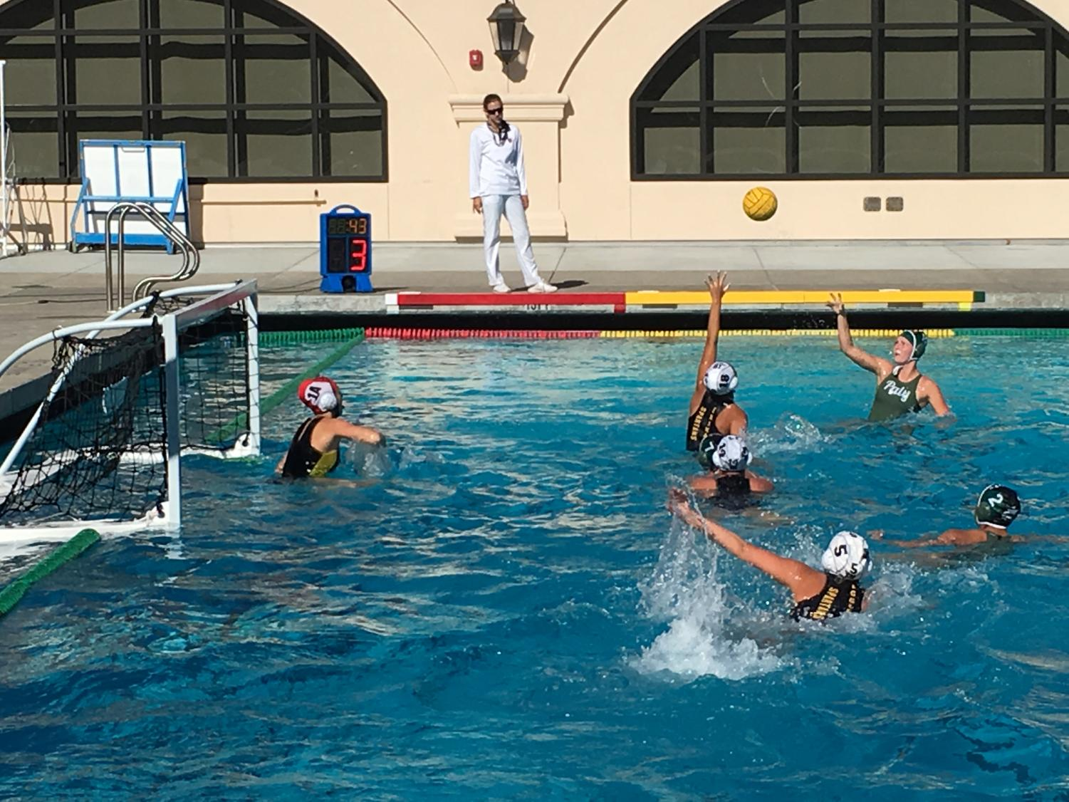 Sophomore Lulu Gaither shoots the ball in the final seconds of the possession. The Palo Alto High School water polo team lost 8-7 against Mountain view on Tuesday. Photo: Ryan Wisowaty.