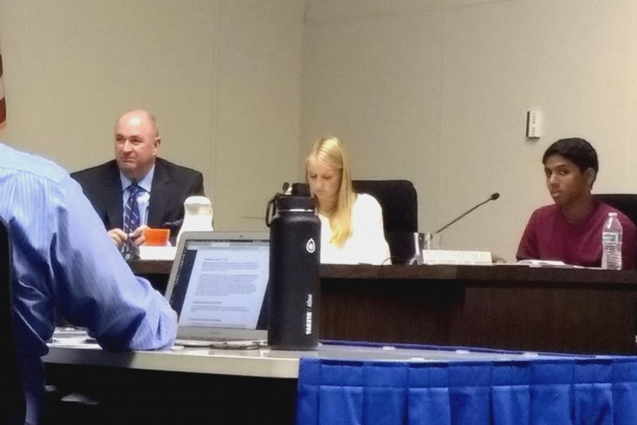 Palo Alto Unified School District superintendent Don Austin (left) and student board representatives Caroline Furrier (center) and Arjun Prabhakar (right) listen to a presentation about low CAASPP participation rates. Furrier suggested that teachers should try to clear up students' schedules during testing week.