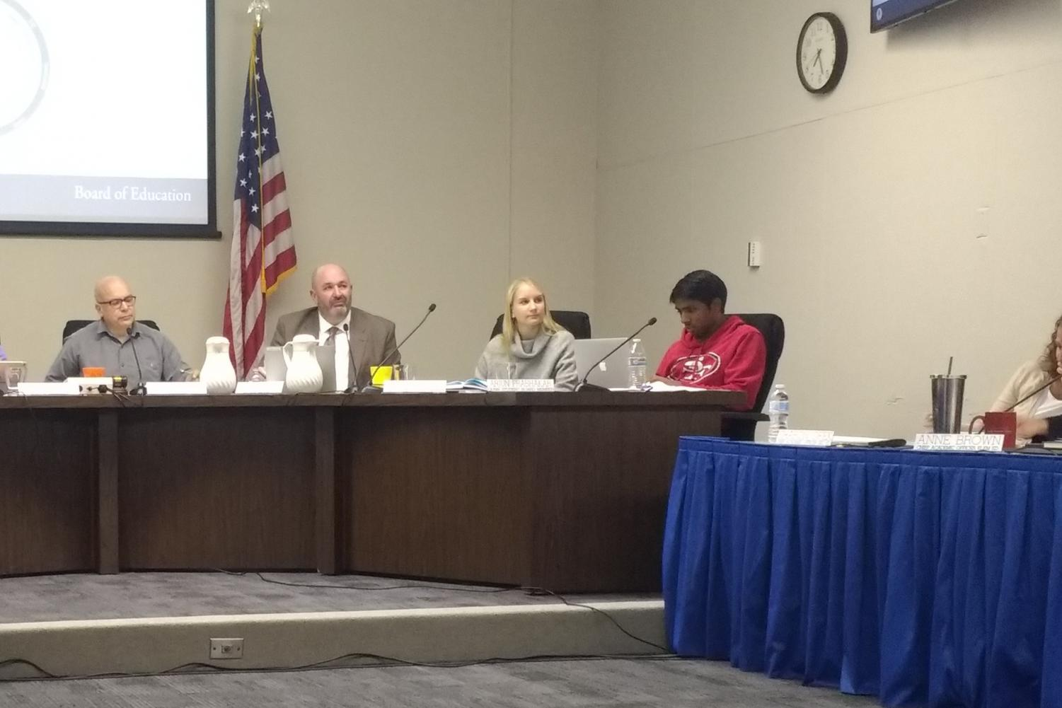 """The Palo Alto Unified School Board listens to Komey Vishakan, the district manager of policy and legal compliance (not pictured), summarize the revised Memorandum of Understanding with the Palo Alto Police Department at a board meeting on Tuesday. Vishakan said that the memorandum was long overdue. """"This was due back on August 14, 2017, so we are under pressure to get this completed,"""" Vishakan said."""
