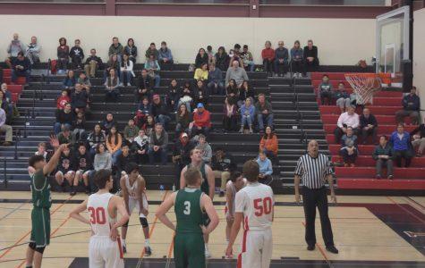 Boys' basketball team defeats Gunn in thrilling match