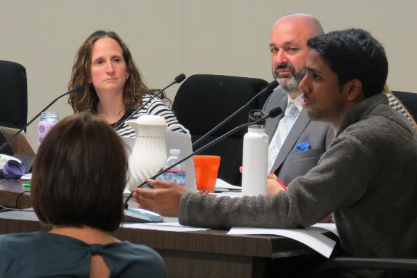 """Student board representative and Gunn High School senior Arjun Prabhakar voices his opinion on building affordable housing for teachers at a Board of Education meeting on Tuesday. Prabhakar expressed his support for the proposal, saying that if teachers had the time to attend afterschool events instead of spending the time commuting, relationships between students and teachers would improve. """"Teachers being able to go to plays, sports games, all those things where you can see teachers in an out-of-classroom context and maybe get to know them better would definitely help all students feel more comfortable with their teachers, Prabhakar said."""