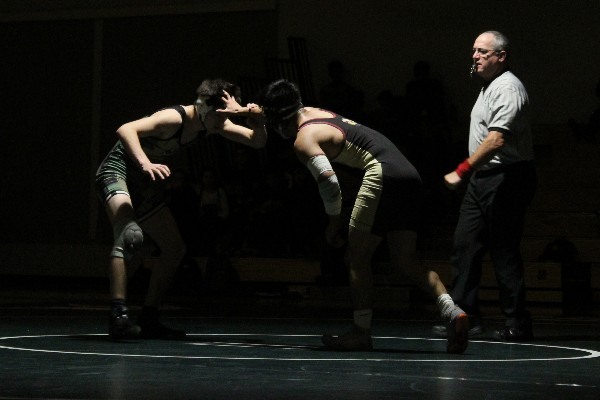 "Sophomore Halo Lynch faces off against his opponent, Cupertino junior Ean Bennett, during a dual meet on Thursday at Palo Alto High School. Head coach Jon Kessler said that the team performed well overall. ""I thought we did pretty good, maybe more so finishing guys when they were on their back,"