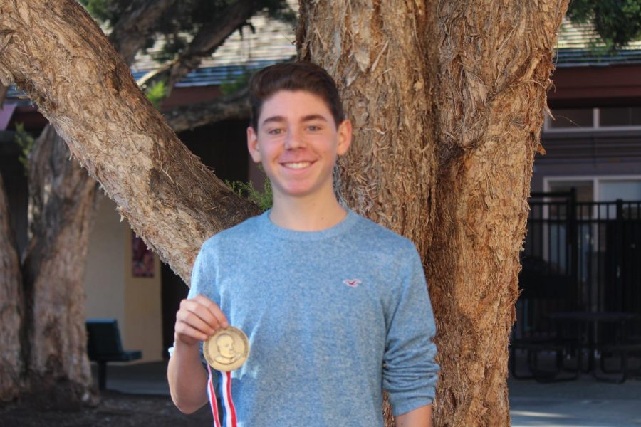 Sophomore varsity debater Alex Selwyn poses for a picture with his medal from the Martin Luther King invitational at James Logan. Selwyn began to prepare for the MLK invitational after attending a debate tournament in Arizona.