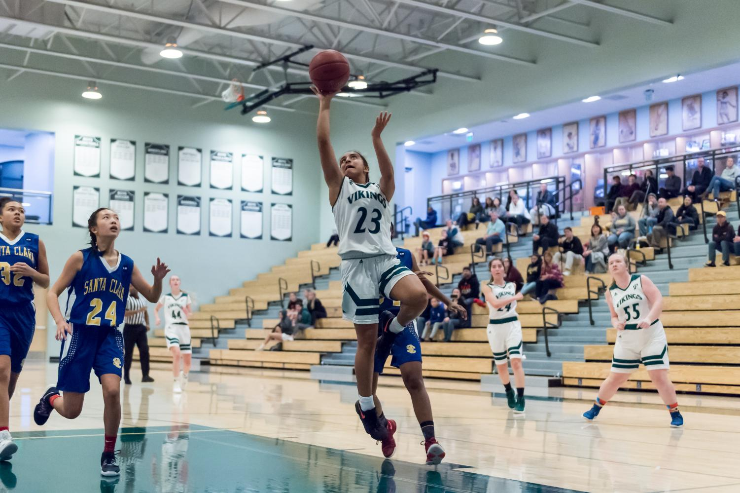 Sophomore Annika Shah goes in for a layup at a game against Santa Clara on Jan. 4.  Photo by David Hickey