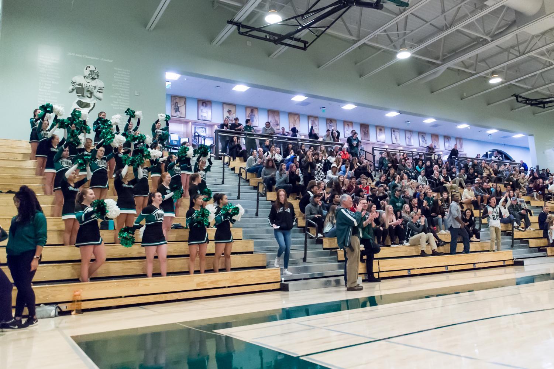 Fans cheer at a girls varsity basketball game.  Photo by David Hickey