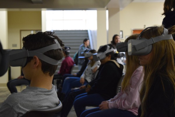 Students use virtual reality headsets to explore a coral reef in the Media Arts Center on Tuesday. ClimateVision club co-president Allison Brandt said that those who see the ocean up close will care about it more than if they had simply read about it.