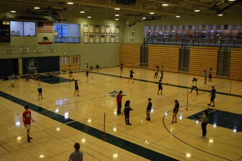 "The Paly badminton team practices after school in the big gym for its next game, which will be at Gunn High School. ""Ultimately, we like to remind our players that the season is long and we"