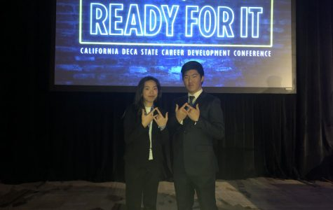 Betty Tsai and Junhyuk Kwak from Palo Alto High School's DECA Club pose for a picture at the State Career Development Conference last weekend in Anaheim. Members Elaine Han and Stephanie Tong placed fourth for their Creative Marketing Project and now have the chance to attend the International Career Development Conference, the annual DECA convention.