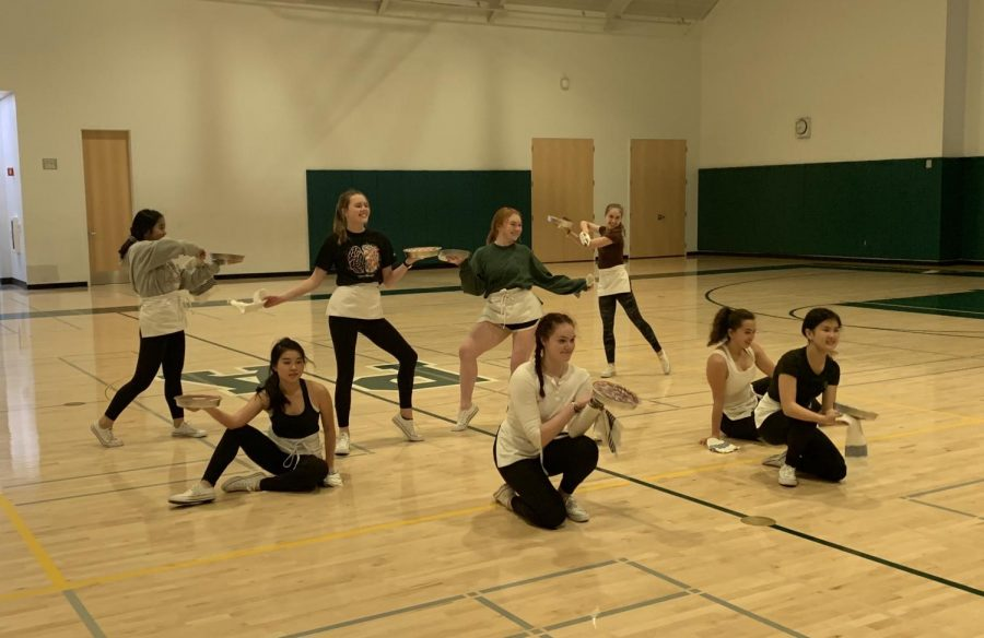 "The Palo Alto High School dance team strikes a pose from a character dance routine in the small gym to prepare for the upcoming national competition. According to captain Iris Hart, this waitress-themed dance, based off the Broadway production ""Waitress,"" has been scoring better and better at each competition. ""We're doing it [the routine] in the gym so we can get our spacing right,"" captain Abby Cummings said. Photo: Dylan Zou"