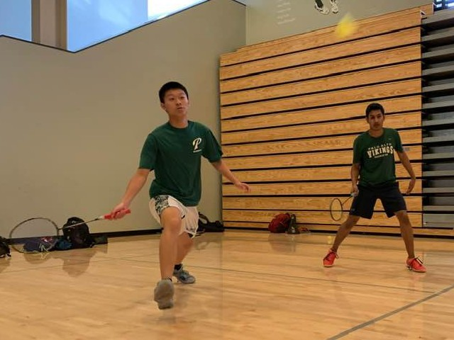 The boys' doubles duo of junior Jonathan Mi and senior Zakir Ahmad attempts to win a point against Lynbrook High School on April 11 at Palo Alto High School. The pair went on to lose the match in three games.