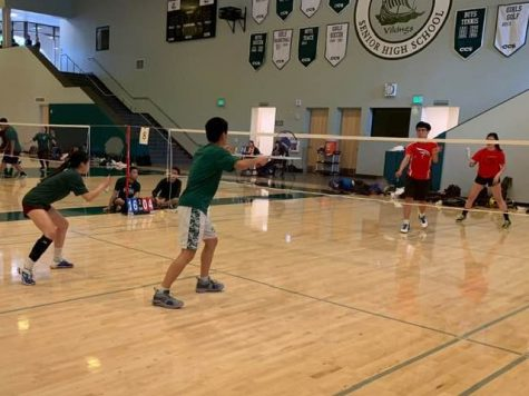 Junior Jonathan Mi and sophomore Ivy Wang prepare to return a serve from the opposing team. Mi and Wang would go on to win the game. Photo: Marvin Zou