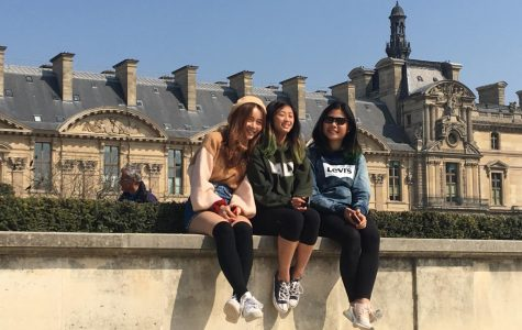 "Senior Jessica Lee, sophomore Samantha Ho, and freshman Xiaohan Li pose outside of the Louvre in Paris. The students participated in an art trip through France and Spain during Spring Break with several other art students from Palo Alto High School. ""My highlight might be going to the Louvre because I've never gone before so seeing so many large scale paintings and things you've only seen in pictures, so that was an interesting experience,"" Li said."