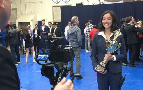 "Senior Ashley Hitchings poses with her trophy after winning first place at California's Speech and Debate State Championships for Lincoln-Douglas debate Sunday, May 5. Paly's congressional debate team and speech team also placed in the top 10. ""For me, competing at states was especially sentimental because it was the final tournament of my four-year debate career,"" Hitchings said. ""Catching up with longtime friends I'd met at tournaments freshman year, cherishing the opportunity to debate at the highest level of argumentation, and enjoying the chance to support and be supported by my other teammates at states was all tremendously gratifying."""