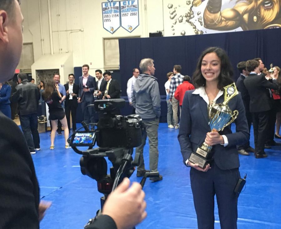 Senior+Ashley+Hitchings+poses+with+her+trophy+after+winning+first+place+at+California%E2%80%99s+Speech+and+Debate+State+Championships+for+Lincoln-Douglas+debate+Sunday%2C+May+5.+Paly%E2%80%99s+congressional+debate+team+and+speech+team+also+placed+in+the+top+10.+%E2%80%9CFor+me%2C+competing+at+states+was+especially+sentimental+because+it+was+the+final+tournament+of+my+four-year+debate+career%2C%E2%80%9D+Hitchings+said.+%E2%80%9CCatching+up+with+longtime+friends+I%E2%80%99d+met+at+tournaments+freshman+year%2C+cherishing+the+opportunity+to+debate+at+the+highest+level+of+argumentation%2C+and+enjoying+the+chance+to+support+and+be+supported+by+my+other+teammates+at+states+was+all+tremendously+gratifying.%E2%80%9D+