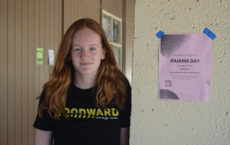 "Junior Jenna Hickey stands next to one of the several posters placed around the Palo Alto High School campus advertising the first monthly Pajama Day this Friday. Although some students are excited about the event, Hickey expressed her concerns about the weather affecting student participation and attire. ""I don't think they should put it when it's 80 degrees outside because I feel like people own more sweatpants and flannel [pants],"" Hickey said. ""I don't think people want to come in short pajama shorts."" Photo: Sophia Krugler"
