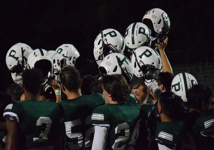 Varsity football triumphs in first home game of the season