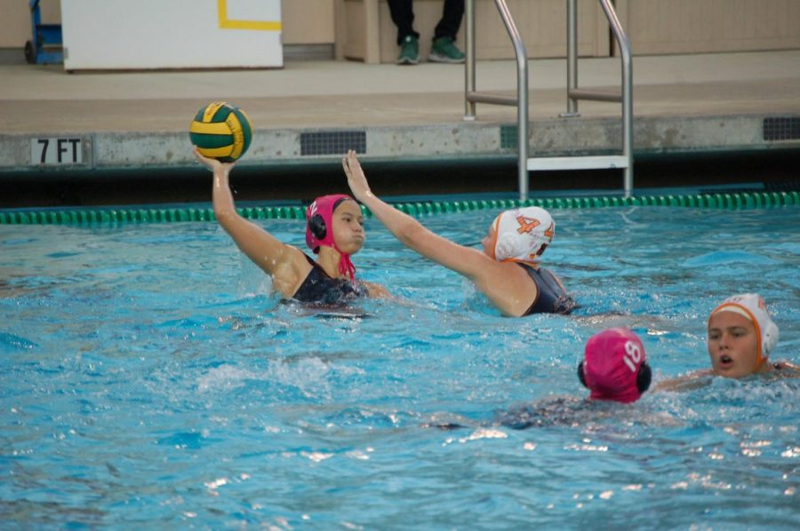 "Senior Alexandra Lee prepares to pass the ball over a Los Gatos defender. The Vikings lost the match 8-3 after their coach was fired. ""I just wanted to play,"" senior Alexandra Lee said. ""We've had a lot of stuff going on and I was just ready to put it all behind me and come out and play."""