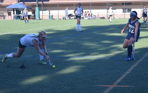 "Senior Emma Siskens prepares to sweep the ball past a Lynbrook High School defender at the Palo Alto High School Girls' field hockey senior night Tuesday. The Vikings (3–2–3) fell behind Lynbrook (1–4–1) early in the match, but scored three goals within the last six minutes of the game to win 3–1. ""It's a new sport and most of us haven't played it, and that can be kind of frustrating,"" Siskens said. ""But [I've learned] to keep trying and not give up."" Photo: Sophia Krugler"