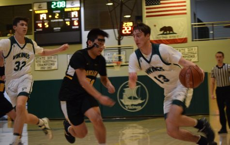 "Senior guard Matthew Marzano drives down the court followed by a Mountain View defender. The Vikings won the game by a narrow two points after the Spartans' buzzer beater three-point shot bounced off the rim. ""My basketball career flashed before my eyes,"" said Marzano. ""I thought I would be done playing basketball if that shot went in, so my heart dropped. I was definitely nervous."" Photo: Arohi Bhattacharya"