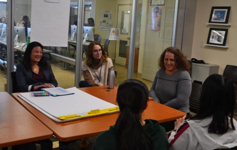 "Director of Human Resources Lisa Hickey (left), Deputy Superintendent Karen Hendricks, and Associate Superintendent Sharon Ofek speak with students at the Needs Assessment meeting on Tuesday in the Media Arts Center. Students brought up what they wanted in a new Paly principal, including one-on-one connection between students and administration, and improving student wellness. Hendricks said the Needs Assessment meetings are instrumental to gain community insight on the principal search. ""This gathering of thinking is an extremely important part of the recruiting and hiring process,"" Hendricks said."