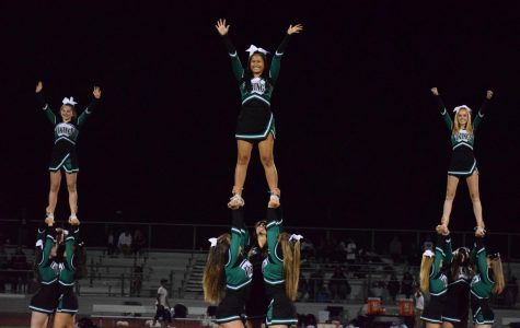 "The Palo Alto High School varsity cheer team performs at a football game in September of 2019. The team will participate in the United Spirit Association national competition Feb 14 to Feb 16 after qualifying in Oct. ""My expectations for my team in nationals is that we bring everything to the mat and have no regrets,"" senior captain Tati Taylor stated over text message. ""All of our hard work is paying off!"" Photo: Amy Yu"