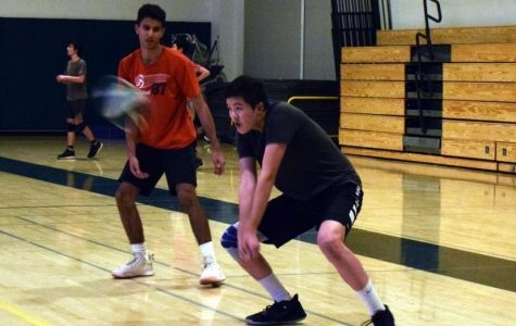"Senior captain and Outside Hitter Tyler Yen passes the ball during boys' varsity volleyball practice in the Small Gym at Palo Alto High School. Yen says he is confident that his team will win the El Camino Division this season. ""We probably need to work on defense a little more and blocking,"" Yen said. ""I think our offense is the best in the league."""