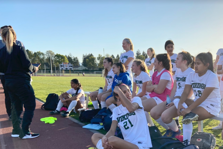 The girls' JV soccer team listens to Head Coach Jessie Berta at half time during its last game of the season against Santa Clara High School. Overall, the team had a successful season, only losing one game, and finishing second in league play. Photo: Malia Wanderer
