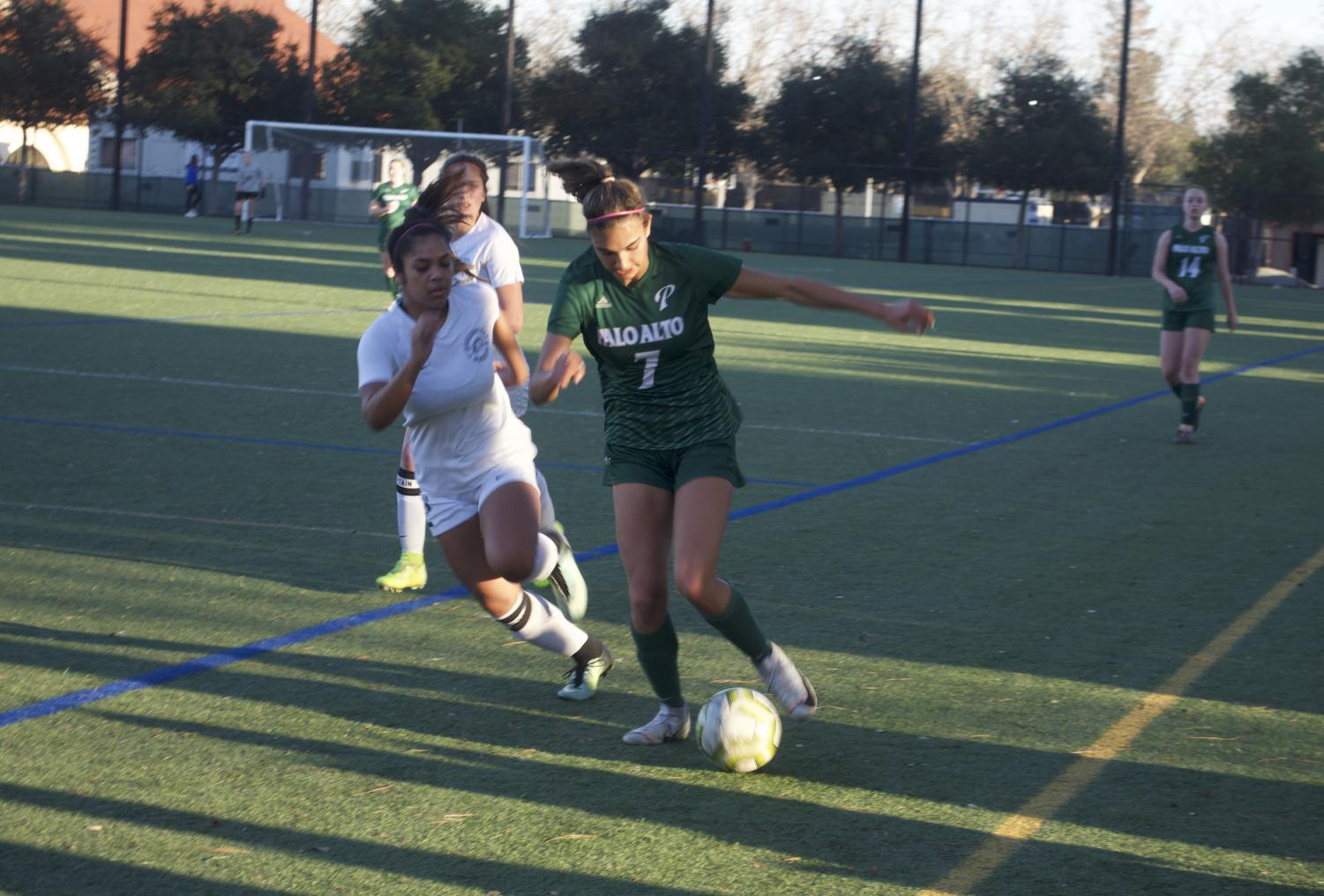 Senior Leila Khan fights to keep the ball moving forward as she pushes her way past a Homestead defender. Photo: Tara Kapoor