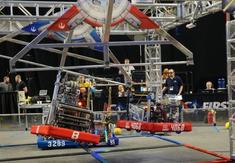 "Nari, the robot built by the Palo Alto HIgh School Robotics team, successfully completes the climb at the Utah Regional competition on March 7, where the team won first place and earned a spot to compete in the FIRST World Championships. However, on March 12, FIRST canceled all competitions in order to prioritize health and safety in response to the coronavirus pandemic. ""I think it's a smart decision,"" driver for the robot and Software Captain Jason Liu said. ""Robotics competitions are packed with people and often in close quarters."" Photo: Julian Kobayashi"