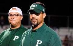 Athletic Director and Varsity Football Coach Nelson Gifford congratulates the Palo Alto High School varsity football team for a victory during the 2019 season at Viking Stadium. Over the summer, some Palo Alto Unified School District campuses reopened for socially distanced summer conditioning and several athletic teams at Paly held practices for five weeks before the Santa Clara County prohibited athletics activities. As athletics and the county start to reopen again, Gifford said he believes that contact sports will be able to play if in-person instruction begins.