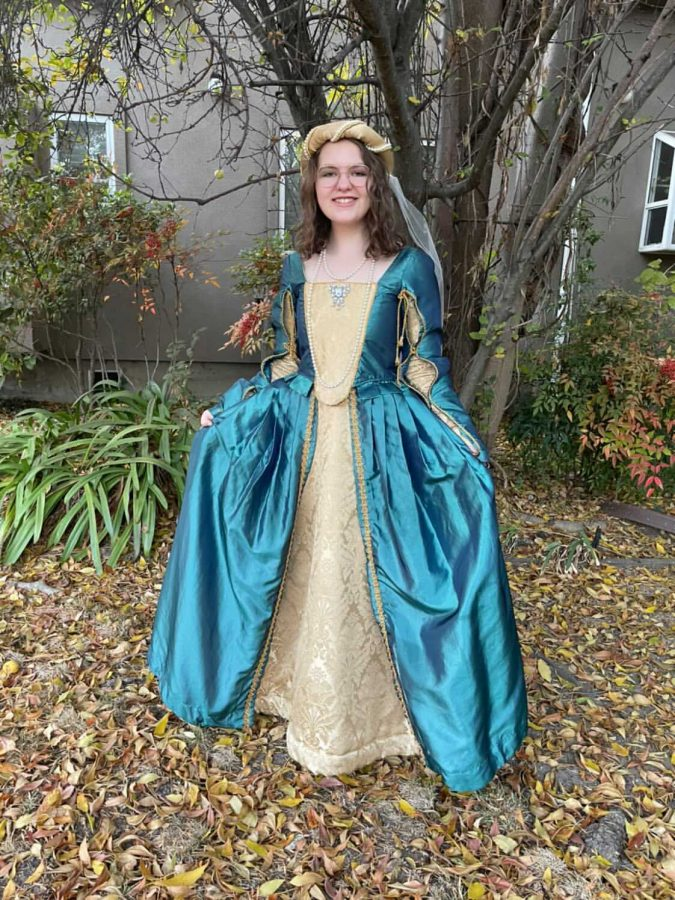 "Dressed in elaborate Madrigal attire, senior Edie Gollub spent the past week preparing to play the role of Lady Jane in Palo Alto High School Choirs' 18th annual Madrigal Feaste. Students prerecorded their videos individually and are looking forward to the premiere of the first ever virtual Madrigal Feaste at 7 p.m. Friday. ""I'm really proud of both my fellow choir kids and our teachers alike,"" Gollub said. ""We've been able to go way beyond what I ever thought a choir could do virtually and put out some really amazing stuff."""