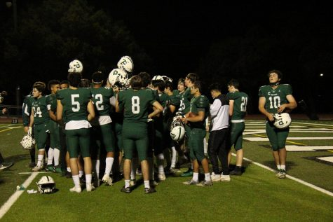 "Palo Alto High School student-athletes huddle after a game with no masks or social distancing. With the end of the pandemic in sight, Palo Alto Unified School District has done little to spread awareness or enforce social distancing guidelines. ""I think it"