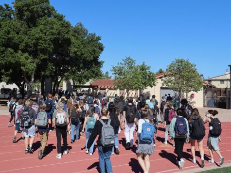 "Palo Alto High School students evacuate their classrooms and head towards the football field after a fire alarm on Wednesday morning. [[ABCD caption missing ""B"" for background]] Junior Giada Parigi reported that the volume of the fire alarm caused an atmosphere of confusion. ""It [the fire alarm] seemed much louder than it has been in the past, so no one could really hear what was going on,"" she said. Photo: Daniel Garepis-Holland."